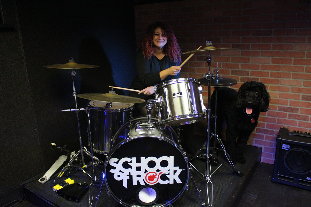 Owner and General Manager of School of Rock Monica Rubin, with mascot Wally, said that if she could play one instrument, it would be the drums.