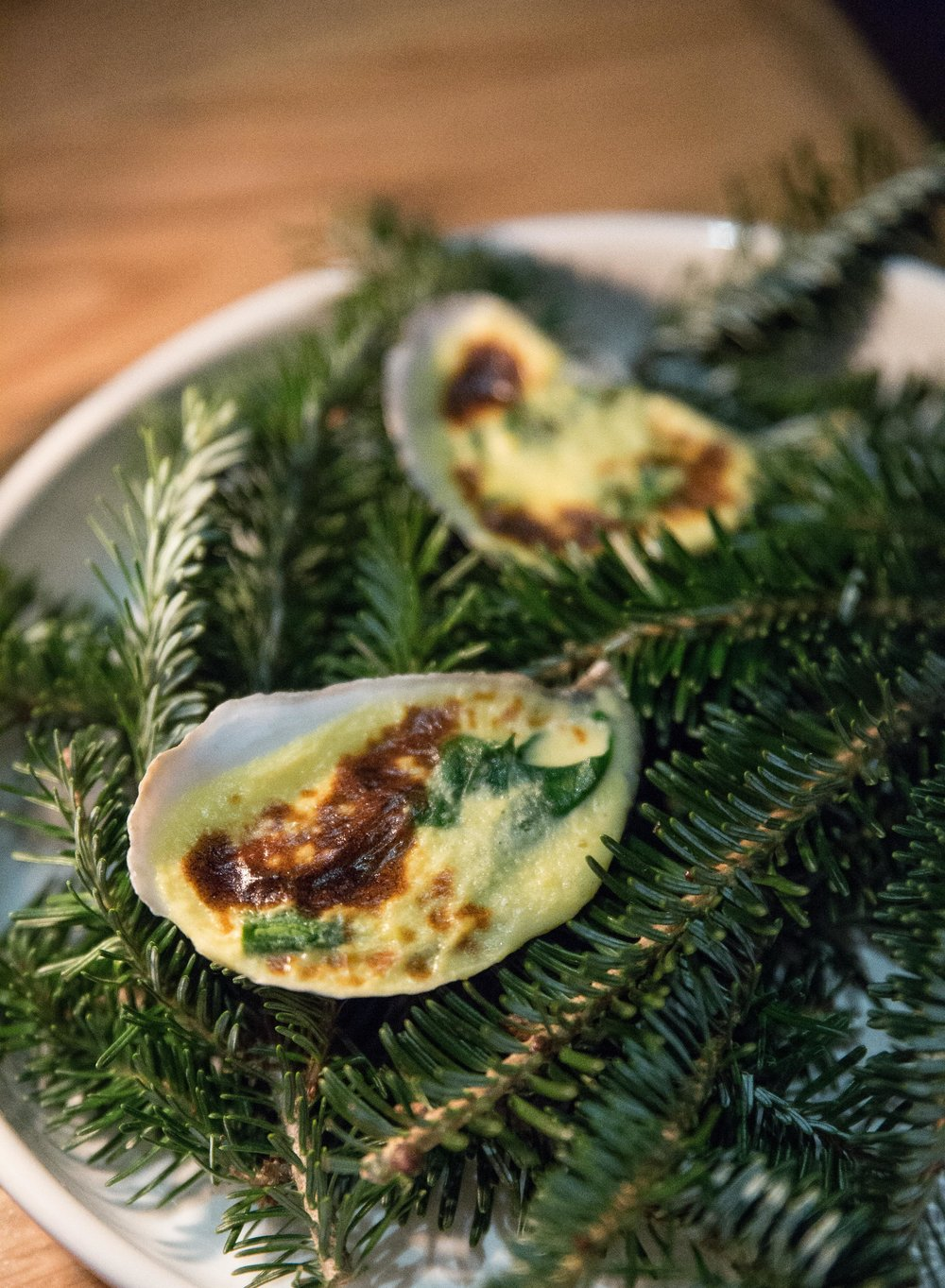 The Blue Point Oysters at Jema are served with hollandaise sauce and spinach. They're perfectly smooth and burst with Atlantic freshness.