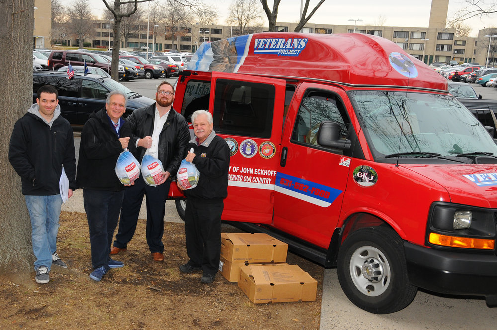Pictured above, from left: Ben Branat, volunteer; Nassau Executive Edward Mangano; Michael Haynes, chief government affairs officer, Long Island Cares; and Ralph Esposito, director, Nassau Veterans Service Agency.
