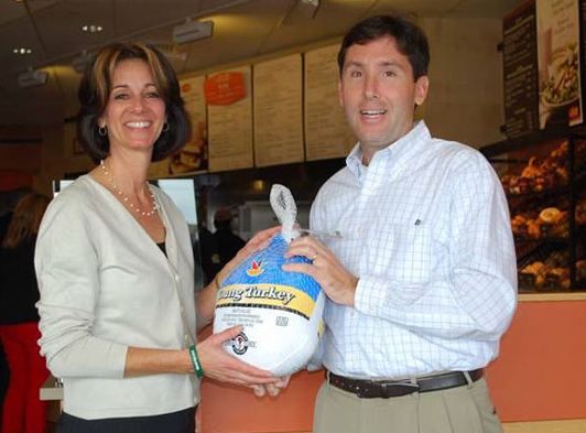 Island Harvest CEO Randi Shubin Dresner, left, is pictured with and Greg George, vice president of operations for Doherty Enterprise Inc., the Panera Bread franchisee on Long Island.