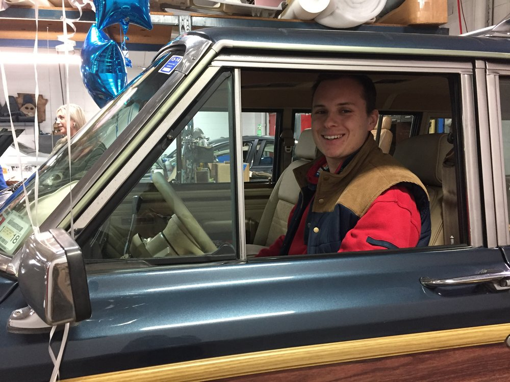 Three years after his cancer went into remission, Lloyd Harbor's Kyle Gutman is pictured in the fully-restored 1989 Grand Jeep Wagoneer.
