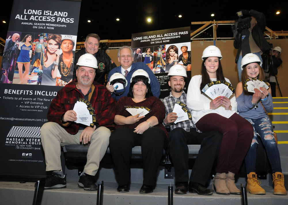 Pictured in the front row, from left, are: Joe and Maryanne Campanelli, their son John, his wife Megan and Maryanne's goddaughter, Gina Courtesis. Pictured in the second row, from left, are: Nassau Legislator Steve Rhoads and Nassau Executive Edward P. Mangan