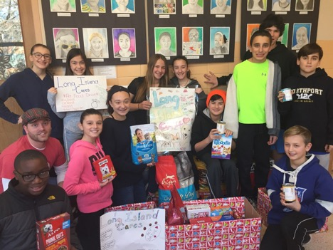 East Northport Middle School SHARE members collected 575 pounds of donated pet food during their second annual Long Island Cares-Pet Food Drive to benefit less fortunate families and their pets.