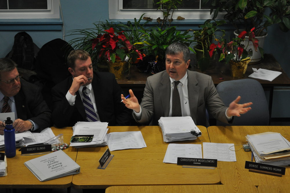 Huntington Zoning Board of Appeals Chairman Christopher Modelewski is pictured during a past ZBA meeting.