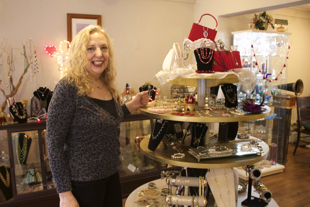 "Janet DeLeva, owner of Gorgeous ""The Salon"" & Treasures, offers hair styling to clients while giving them the opportunity to shop in her vintage shop."