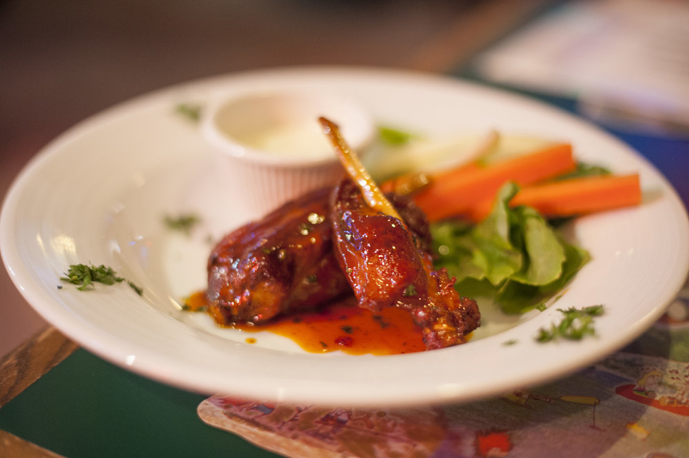 The Fried Pork Dragon Wings at The Shamrock are fried, then sauteed in a dragon sauce that delivers a sweet and tangy spin on traditional wings.