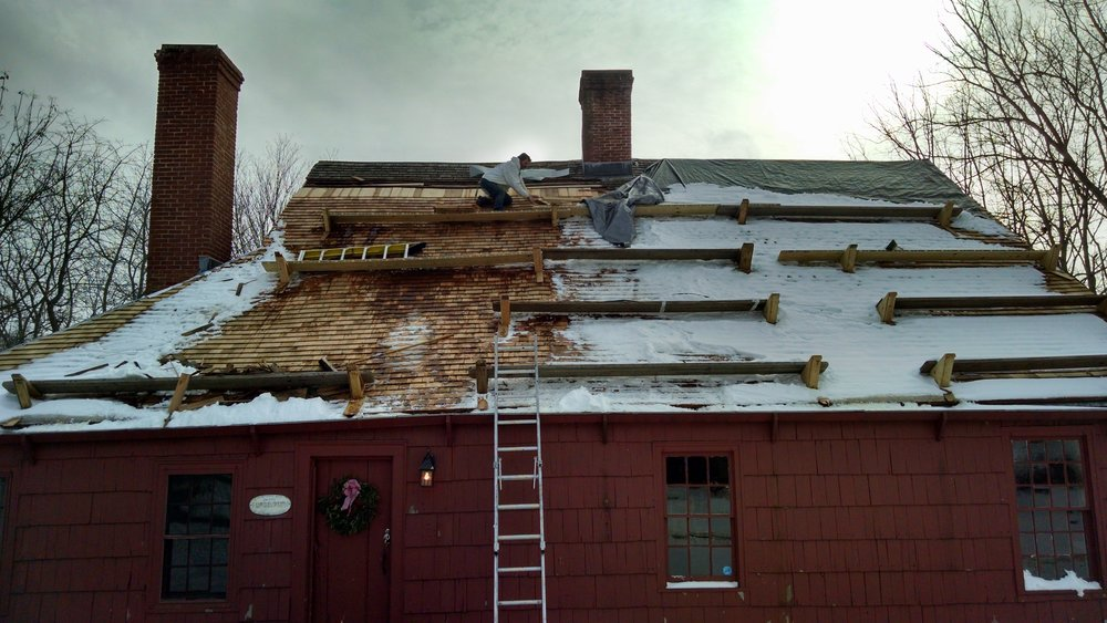 John Frintzilas, owner of J & C Roofing, worked through December and January to replace and restore the wooden roof of the historic Henry Lloyd Manor House.