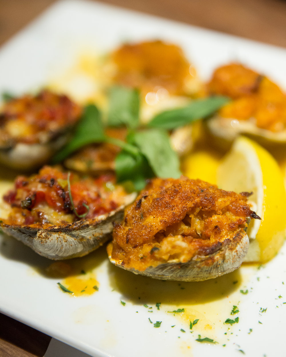 The Clams Trio special plate features a variety of antipasti menu items including two Baked Clams, Clams Casino and Stuffed Clams, which all brimmed with impeccable freshness.