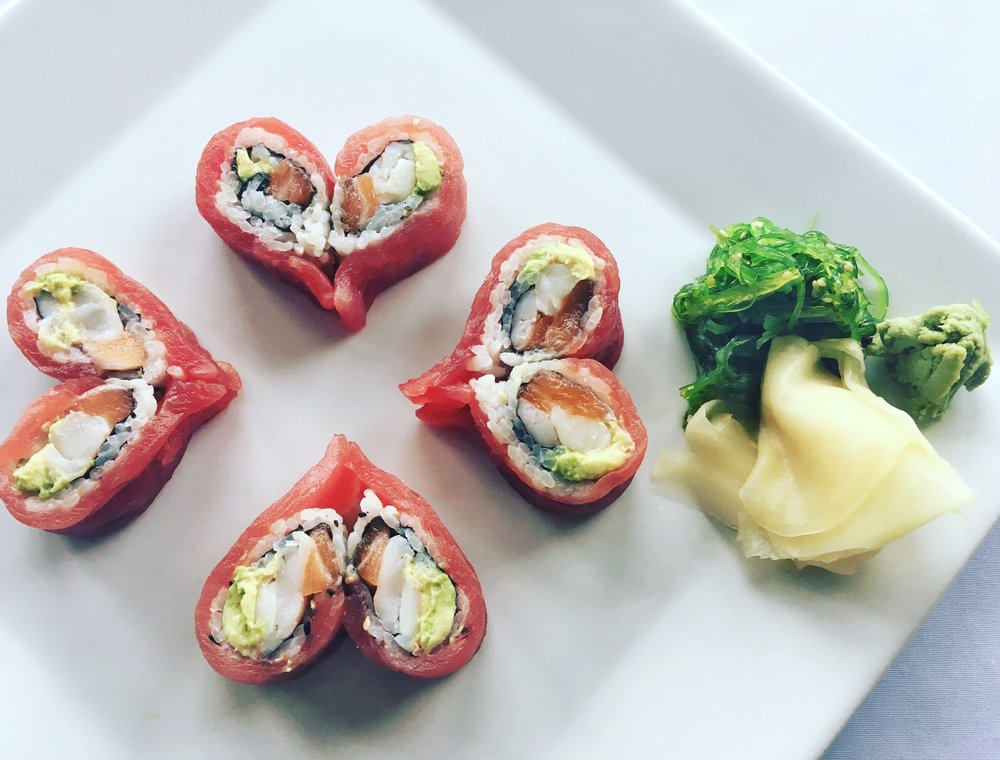 Mill Pond House Restaurant's special Valentine's Sushi Roll appetizer of salmon, shrimp, and avocado topped with yellowfin tuna.