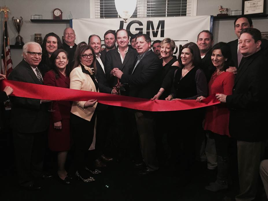 JGM Construction Development, which recently expanded to Huntington, hosted a ribbon cutting ceremony on Friday. Members of the construction firm are pictured above with state officials and members of the Huntington Township Chamber of Commerce.