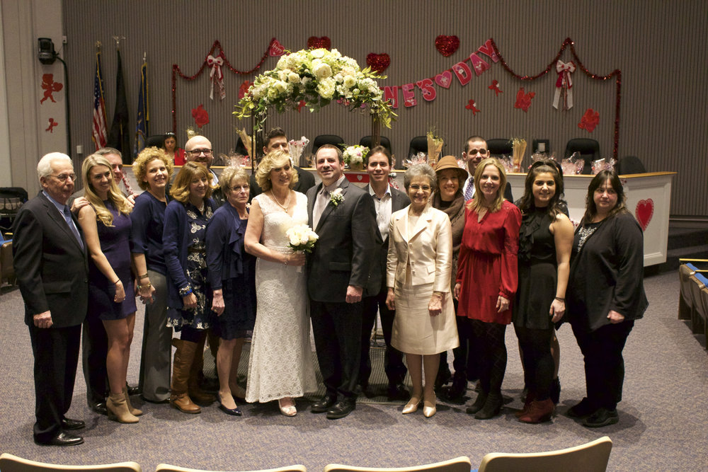 Family and friends of the newly-married Anne and Robert Scrima are pictured with the couple during the annual marriage marathon at Huntington Town Hall on Tuesday.