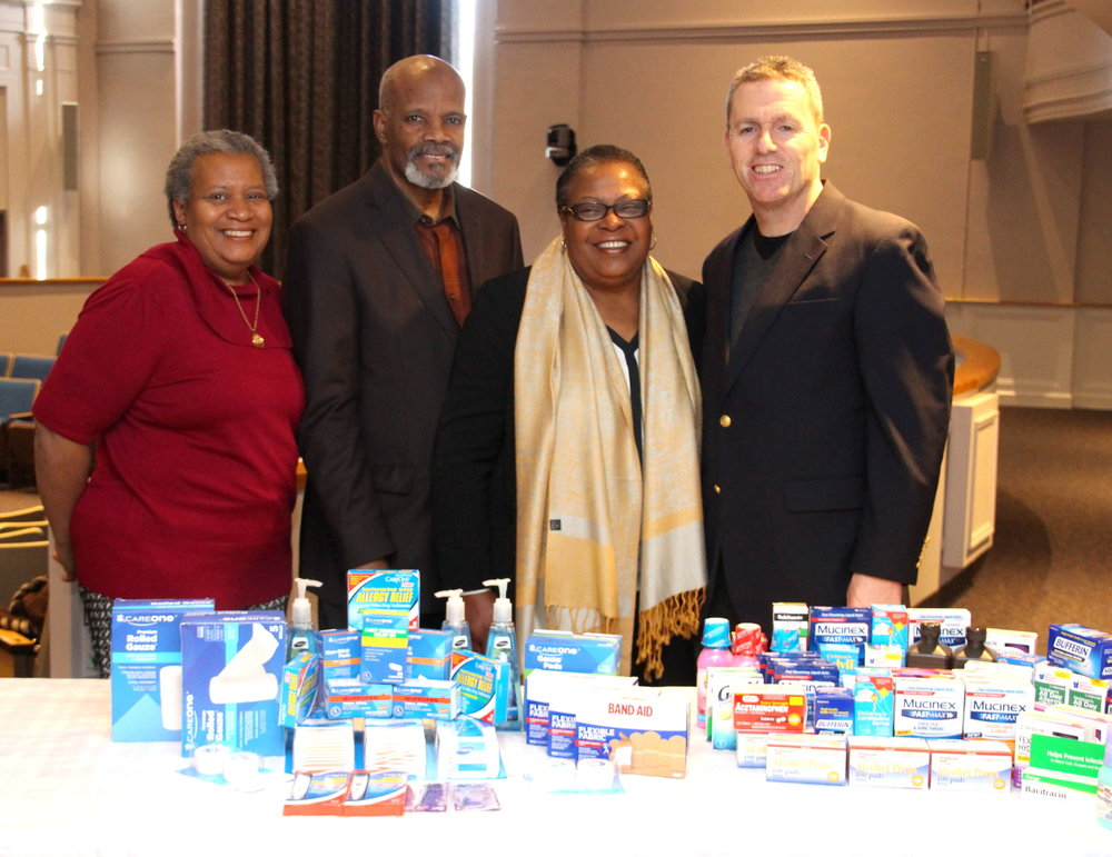 Councilwoman Tracey Edwards, far left, and Councilman Mark Cuthbertson, far right, with Pastor Georges Franck, Ginette Rows and some of the medical supplies donated by the two Councilmembers, along with items that were generously donated by 110 Pharmacy & Surgical in Melville.