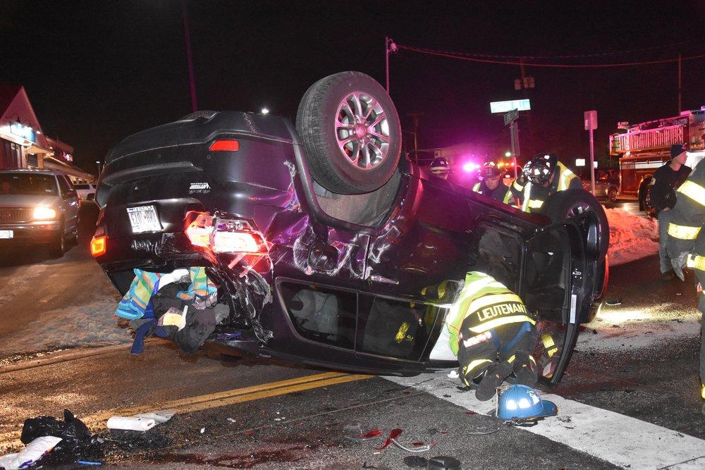 An overturned Jeep rests on Jericho Turnpike following a three-vehicle crash on Jericho Turnpike on Tuesday.