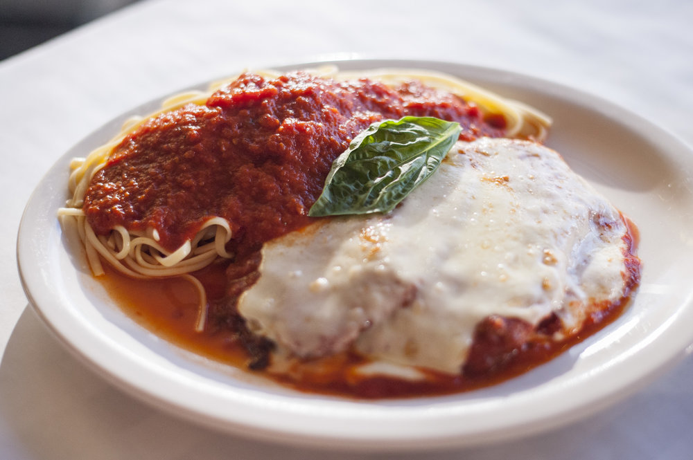 The one-of-a-kind Eggplant Parmesan with linguini features plum tomato sauce, topped with melted mozzarella cheese, all sans breadcrumbs, lending itself to a purer, earthy experience.