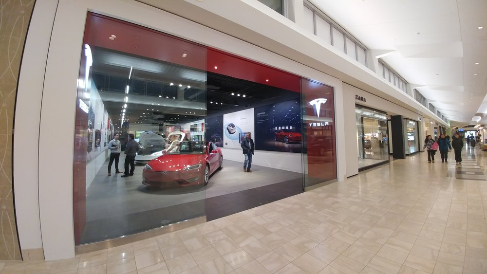 The new Tesla gallery, pictured above, at the Walt Whitman Shops showcases the electric car company's Model S and X.