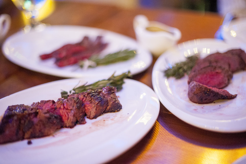 IMC serves these three cuts of Wagyu steak with bundles of rosemary and thyme to dip into a side of au jus sauce made from the beef's own juices.