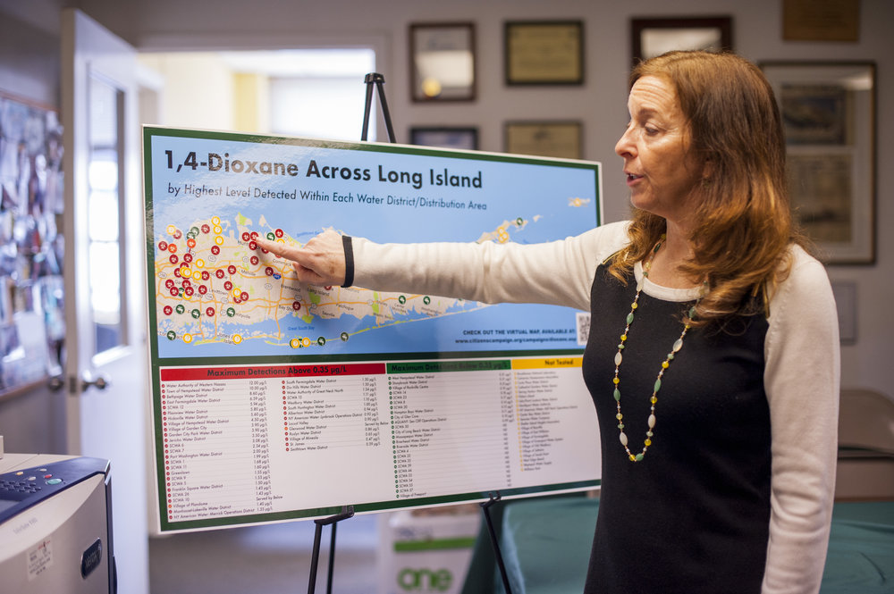 Executive Director of the Citizens Campaign for the Environment Adrienne Esposito points to Huntington and its water distribution points contaminated by 1,4-dioxane, with maximum detections in drinking water that pose potential cancer risks.