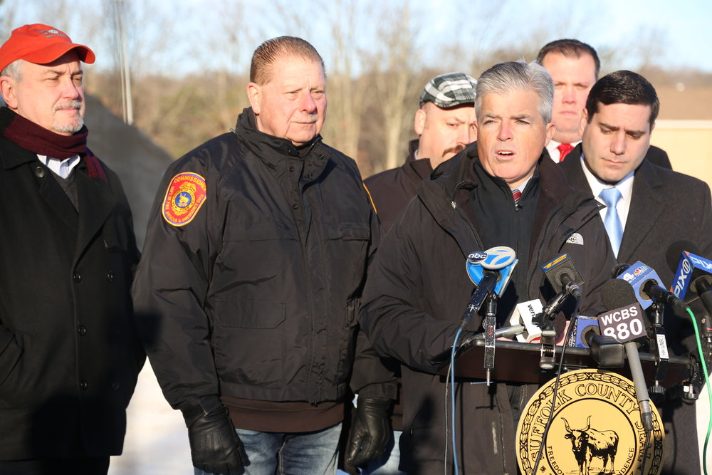 Suffolk Executive Steve Bellone, right-center, speaks Monday during a press conference at a Suffolk public works yard in Commack. (Photo/Suffolk County)