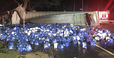 Photo courtesy of the Melville Fire Department Dozens of cases of Bud Light are spilled onto the Long Island Expressway South Service Road after a truck carrying the beer collided with a car just after midnight this morning.