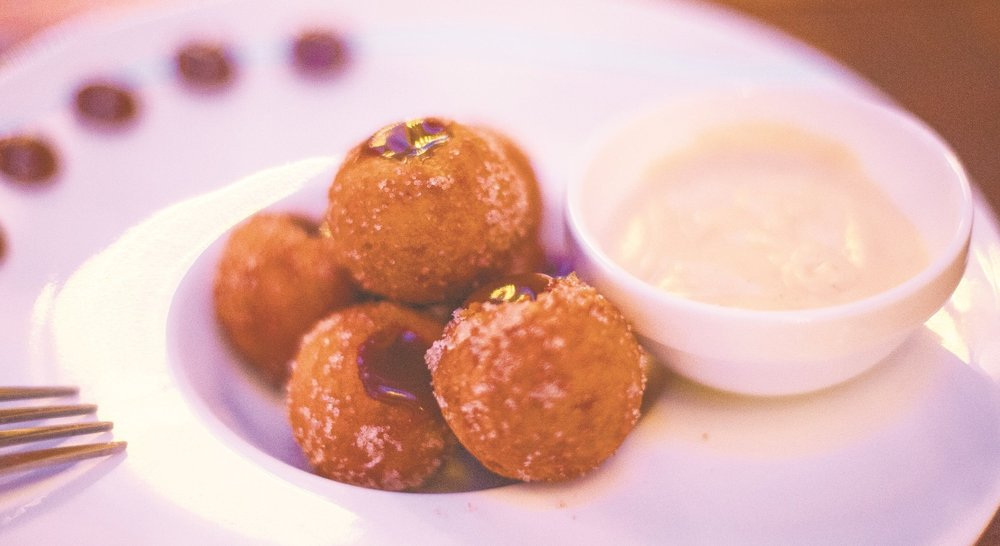 IMC Long Islander News photo/archives  One Restaurant Week choice for dessert at IMC is the IMC Donuts, which are filled with a warm dulce de leche, topped with cinnamon sugar and served with a side of crème anglaise.