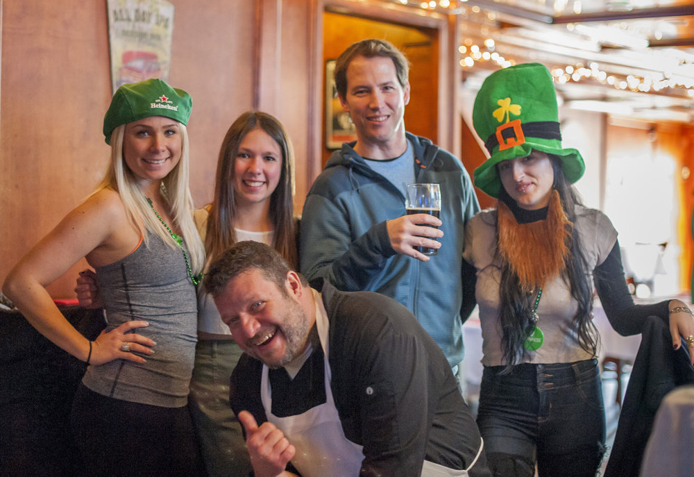 Long Islander News photo/Jano Tantongco From left, bartender Amy Tanner, waitress Lauren Meltzer, a bar patron, waitress Giulia Gallo, with Chef Frank Arcarola in the front pose for a picture on St. Patrick's Day at Christopher's pub and eatery.