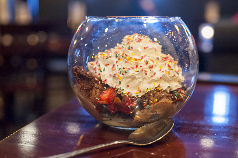 The Party In A Glass mixes up into a fish bowl vanilla and chocolate gelato, caramel, chocolate, toffee sauce, brownies, mini marshmallows, berries, Oreos and whipped cream.