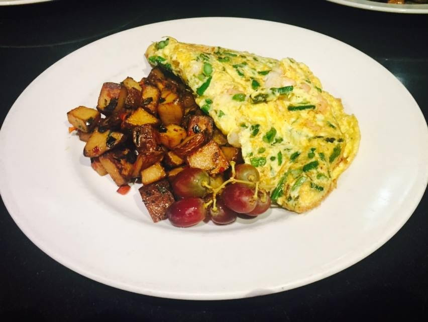 Honu's wild mushroom and honey goat cheese omelet served with home fries and fresh fruit.