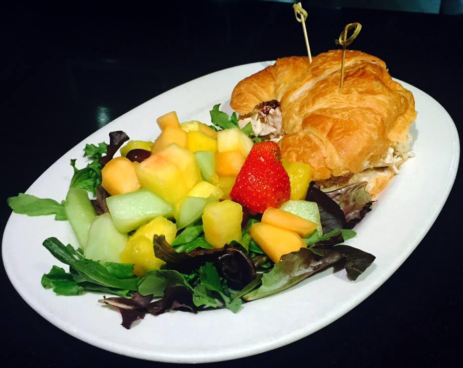 Honu's Waldorf chicken salad with gala apples, walnuts, and celery on a buttery croissant.
