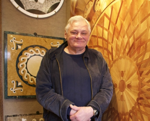 Long Islander News photo/Janee Law  Matt Benkovich, president of C.F.C. Flor-All in Northport, in the medallion alley of his Flor-All showroom, which features medallion floor pieces.