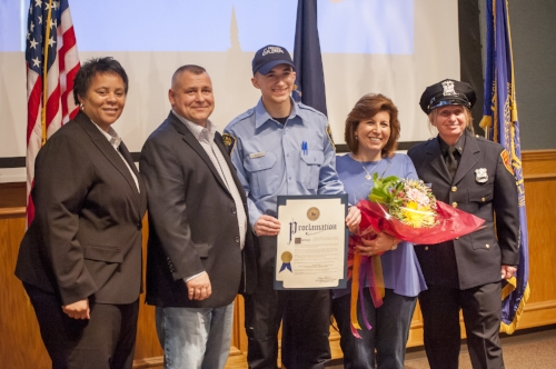 *Long Islander News photos/Jano Tantongco  Bias proudly presents his Suffolk County proclamation, flanked by his parents, as he stands with Deputy Police Commissioner Risco Mention-Lewis (left) and Second Precinct community police officer and Explorer advisor Angela Ferrara.