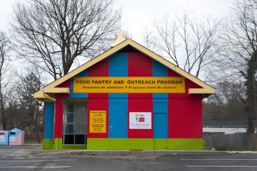 Long Islander News photos/David Weber Before La Misión's food pantry scheduled to open its doors on Tuesday, the Town of Huntington issued a summons for unapproved signage to property owner Dominic Mavellia.