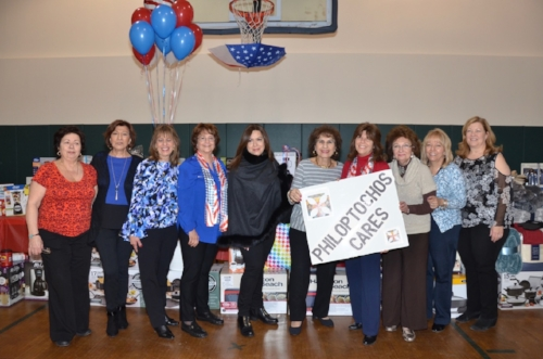 "Photos by Iris De Vita  Members of the Ladies Philoptochos of the Saint Paraskevi Greek Orthodox Shrine Church in Greenlawn are all smiles during the ""Shower of New Beginnings,"" which was hosted to collect household items for the Northport VA's Homeless Service Project."