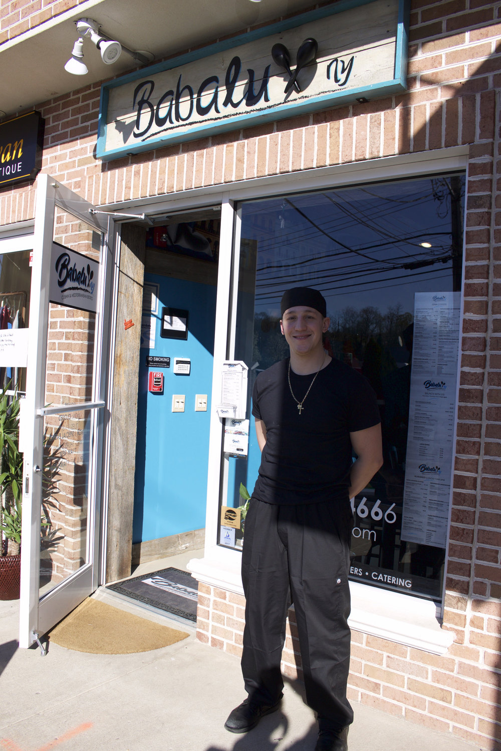 Long Islander News photo/Janee Law  Babalu Cuban & Mediterranean Bistro owner and chef Alan Gotay is pictured outside of his 286 New York Ave. bistro, which opened last night.