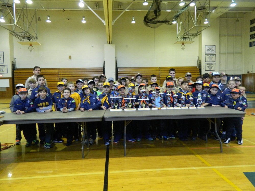 Prior to the start of the Matinecock District's annual 2017 Pinewood Derby race, all of the participating Tigers, Cubs, and Webelos pose for a photo with the trophies.