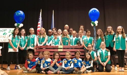 Photo by Christine Reilly  Girl Scout Troop 239 held a ribbon cutting Friday before Earth Day to celebrate the completion and installation of its first recycled bench installed at Silas Wood School Sixth Grade Center School in Huntington Station.