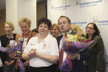 Huntington Hospital Chief Nursing Officer Susan Knoepffler, RN; Director of Nursing Education Donna Tanzi, RN; and Executive Director Gerard Brogan, Jr., MD; are pictured with hospital staff.