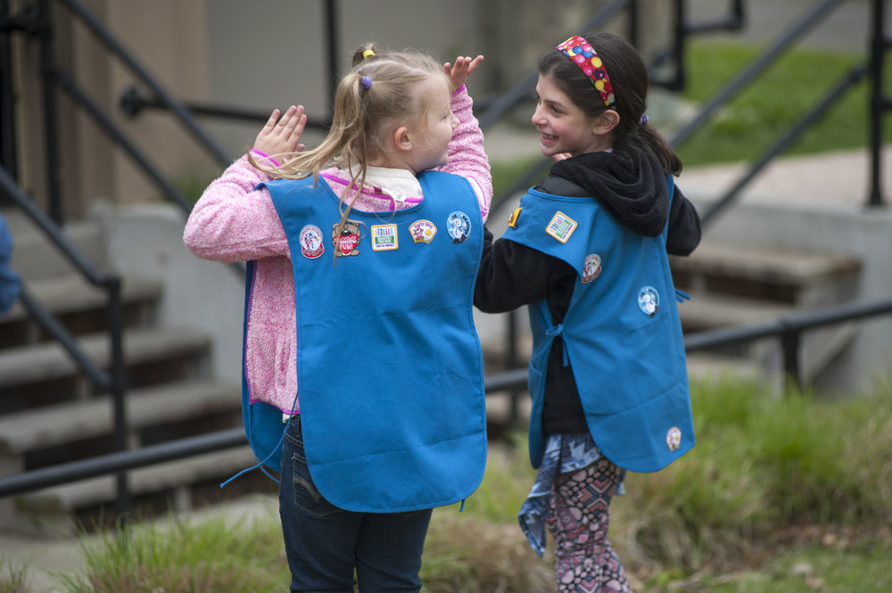 Two Girl Scouts copy the dance moves of Mike Soloway, a children's musician. Soloway and his band were one of the three performances who played the Chapin Rainbow Stage at the Tulip Festival, along with guitar ensemble Inkarayku and puppeteer Janice Buckner.