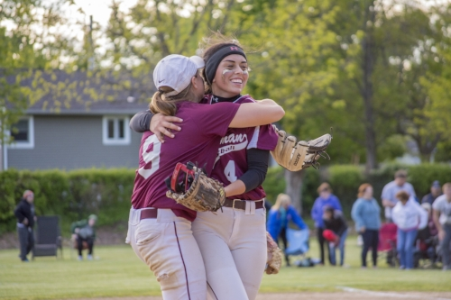 Long Islander News photo/Andrew Wroblewski Whitman senior pitcher Taylor Epstein, right, is embraced by shortstop Noelle Bryggman after Monday's playoff win over William Floyd.