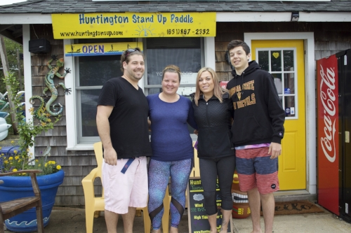 Long Islander News photo/Janee Law Huntington Stand Up Paddle prepares for the upcoming season, as the summer inches closer. Pictured from left to right, volunteer Rich Buttine, owner Katie Buttine, instructor Jackie Adamcewicz and volunteer Christian Cuciniello.