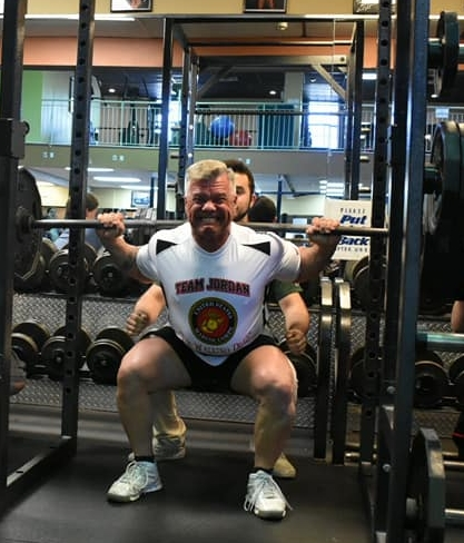 Photo courtesy Tom Gianni In the Barbell Benefit powerlifting competition, Huntington Station man Brian Dwyer squats 405 pounds, raising a total of $4,697 to benefit Long Island vets.