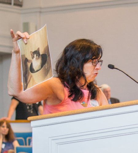 Long Islander News photo/Jano Tantongco Gina Florentina James, one of 24 supporters who pleaded to the town board to reconsider their decision to cut ties with the League For Animal Protection of Huntington, holds up a photo of the cat she adopted from the shelter last August.