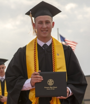 A Commack High School graduate is all smiles after receiving his diploma on Friday. (Long Islander News photo/Andrew Wroblewski)