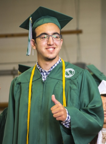 A soon-to-be graduate gives a thumbs up at Harborfields High School's ceremony Saturday morning.  (Long Islander News photo/Andrew Wroblewski)