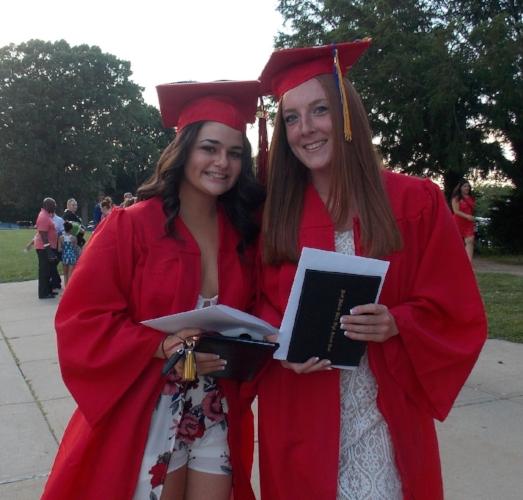 Half Hollow High School East grads Julia Bretschneider and Jenna Bottone smile with diplomas in hand. (Long Islander News photo/Rachel Stanislawek)