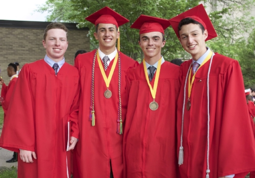Half Hollow Hills High School West grads Daniel Kowalski, Nicholas Genovese, Matthew Barone and Jeremy Shuster are pictured after Friday's ceremony. (Long Islander News photo/Janee Law)