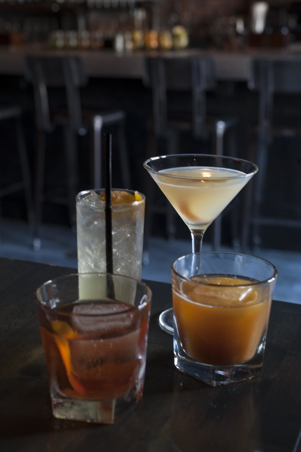 Pictured are some of Old Fields cocktails', the summery Orange South Side (back-left) next to the Corpse Reviver II. In the front row, from left, are a classic New Orleans Sazerac and the Charleston Dragoon Punch.
