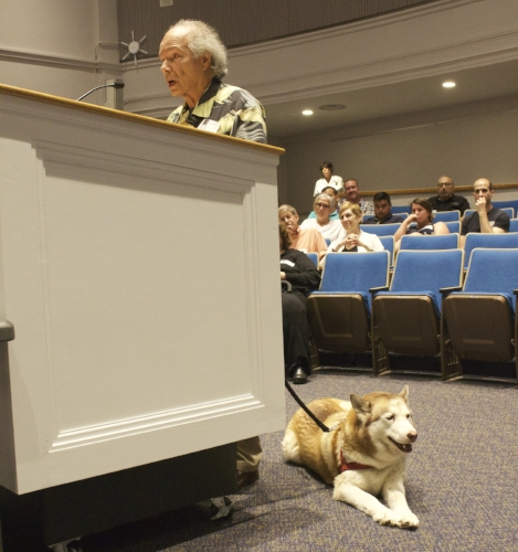 Long Islander News photo/Janee Law Michael Kaplow speaks Tuesday with his service dog. Lola, by his side.
