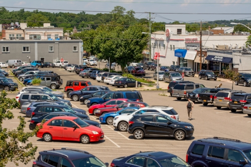 Long Islander News photo/Jano Tantongco Pictured is the municipal lot between Green and New streets in Huntington village, where a 528-space, three-story and four-level parking garage might one day be built.