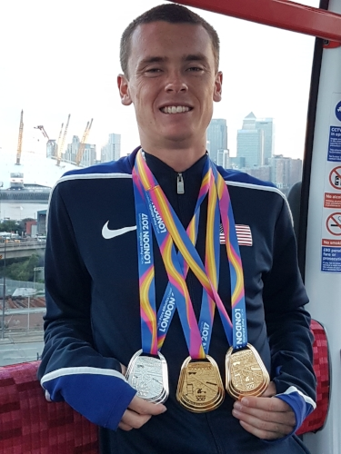 Photo courtesy of Edith Brannigan  Mikey Brannigan, of East Northport, proudly dons the two golds and one silver medals he earned at the World Para Athletics Championships in London earlier this month.