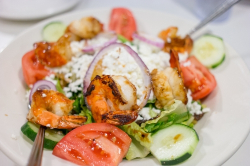 Grilled Shrimp Goat Cheese Mandarin Oranges Walnuts & Raisins, served with mixed greens and a balsamic vinaigrette dressing, is a garden of sweet and savory flavors that make this salad a refreshing start to any meal.